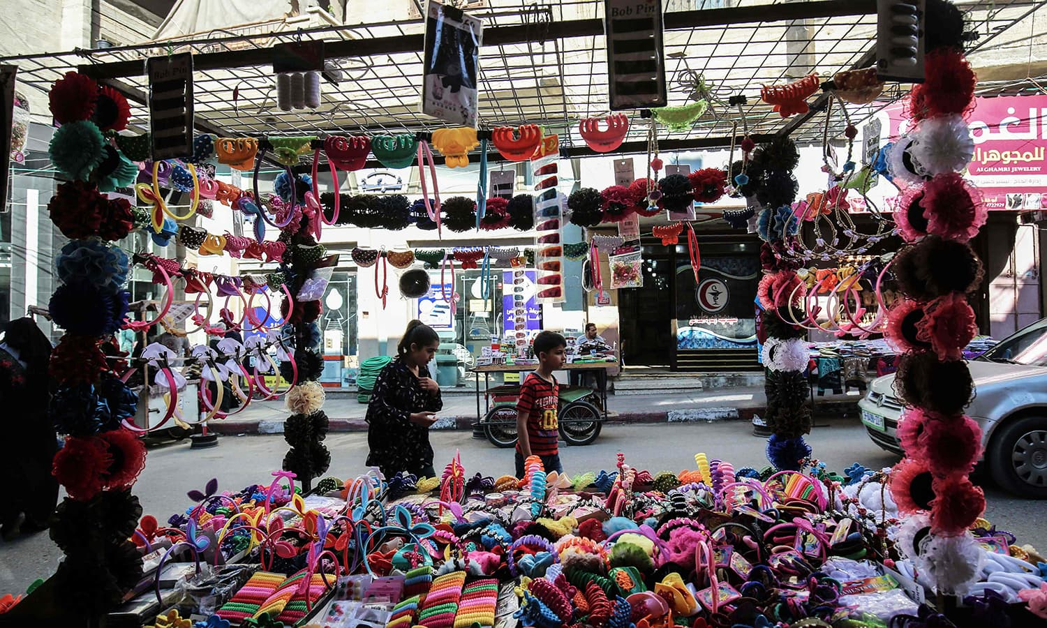 Palestinians shop at a market in Khan Yunis in the southern Gaza Strip a day before the start of the holy Muslim month of Ramazan. — AFP