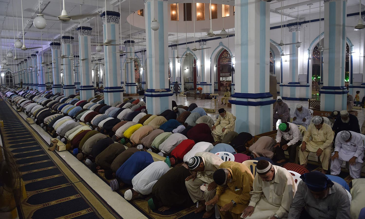 "Pakistani Muslims attend a special ""Taraweeh"" evening prayer on the first day of the Muslim fasting month of Ramazan at a mosque in Karachi. — AFP"