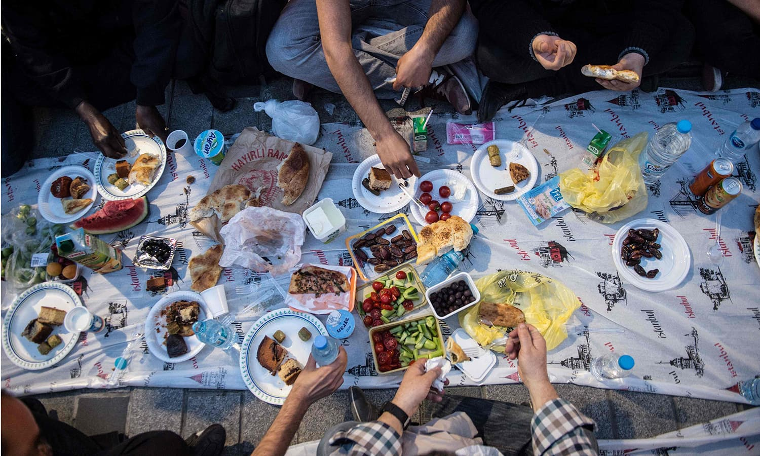People break their fast on May 16 near Taksim Square in Istanbul, during the first day of the holy month of Ramazan. — AFP