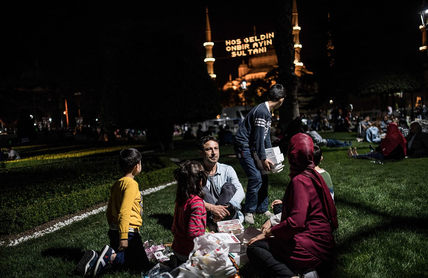 A Turkish family breaks the fast on the first day of Ramazan in front of Blue Mosque at Sultanahmet in Istanbul, Turkey on May 16, 2018. — AFP