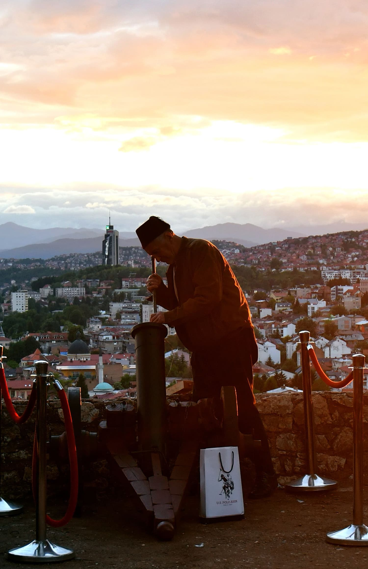 A Bosnian Muslim man loads fireworks mortar, in old town of Sarajevo. Percussion round fired in sunset marks the end of daily fasting, every day during the Islamic holy month of Ramazan. — AFP