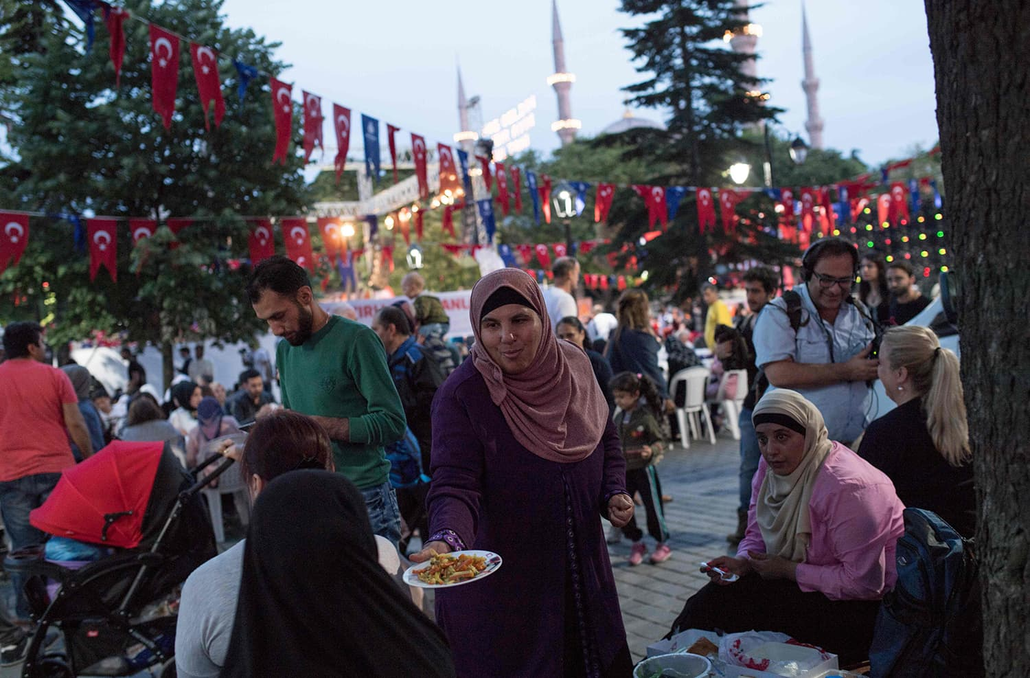 People break the fast on the first day of Ramazan in front of Blue Mosque at Sultanahmet in Istanbul on May 16. — AFP