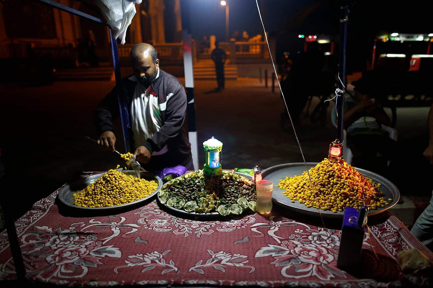 A Palestinian street vendor sells food in Gaza City on May 16. — AFP