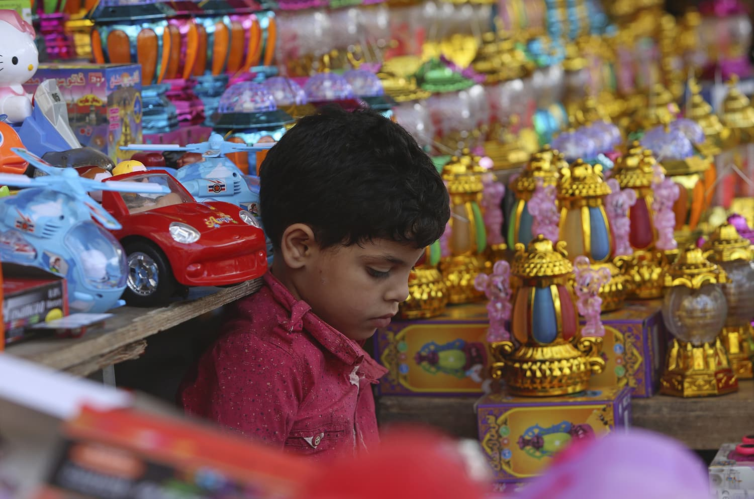 A Palestinian boy shops for a traditional lantern for the holy month of Ramazan, at the main market in Gaza City on Wednesday. — AP