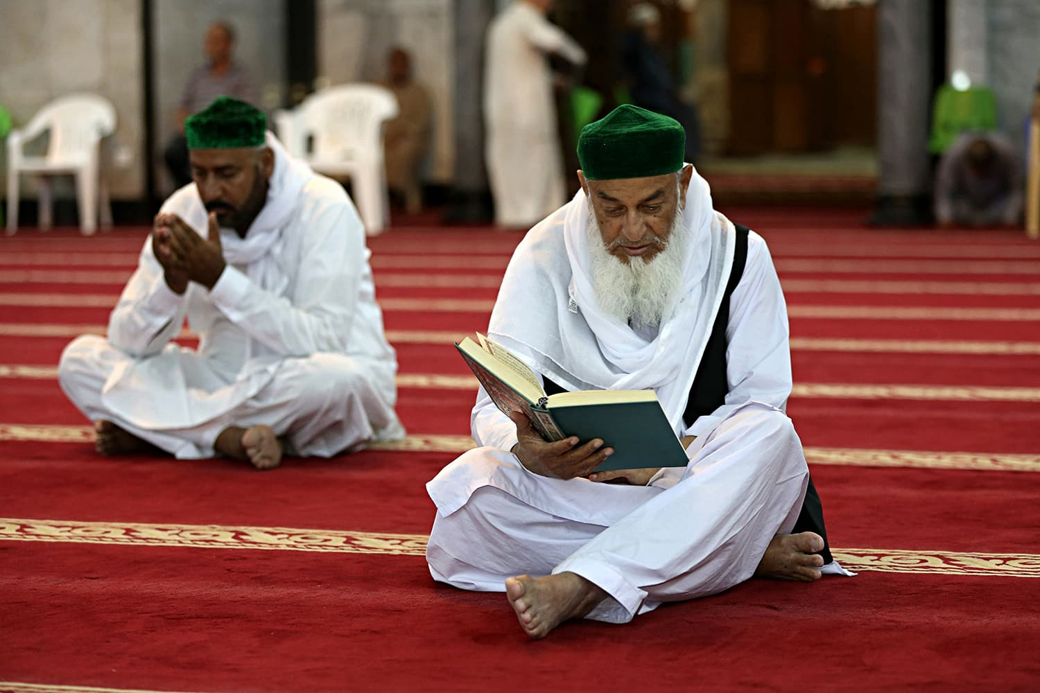 Muslim worshippers read the Quran at Abdul-Qadir al-Gailani mosque in Baghdad, Iraq on Wednesday. — AP