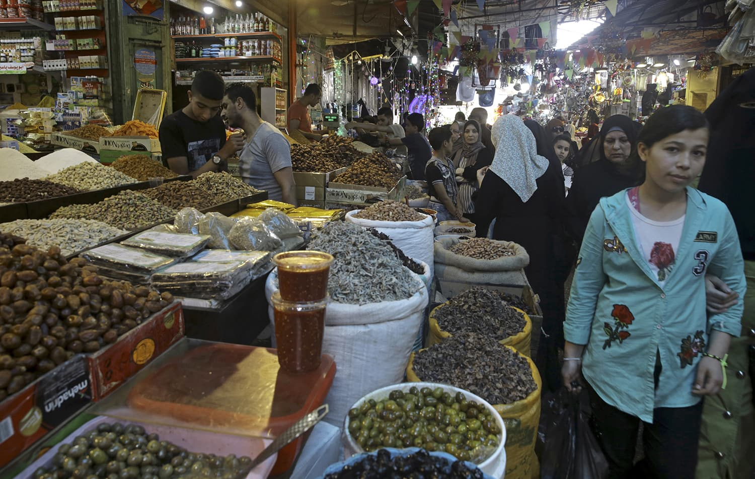 Palestinians shop for the holy month of Ramazan at the main market in Gaza City on Wednesday. — AP