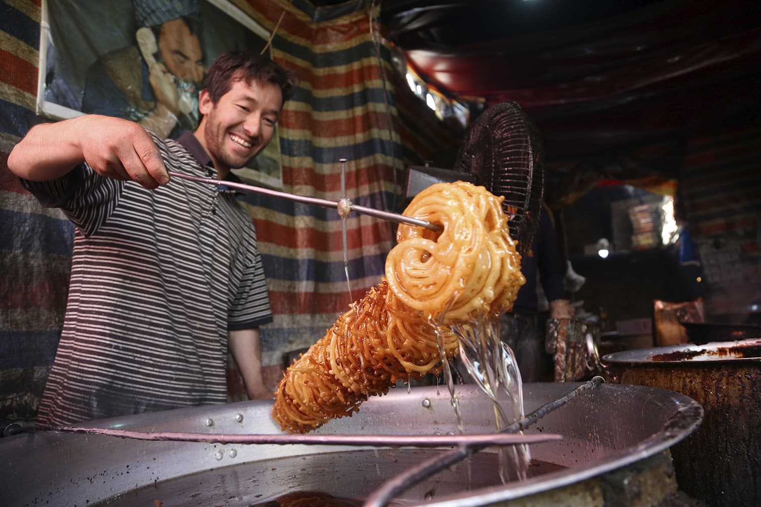 A vendor makes sweets at a traditional factory ahead of the month of Ramazan in Kabul, Afghanistan on Wednesday. — AP