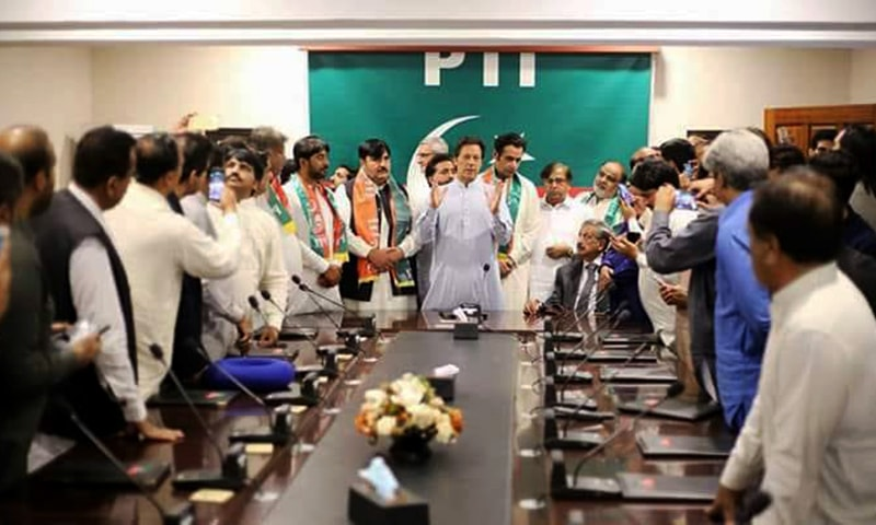 PTI chairman Imran Khan welcomes the Punjab lawmakers into the PTI fold. —Photo provided by author