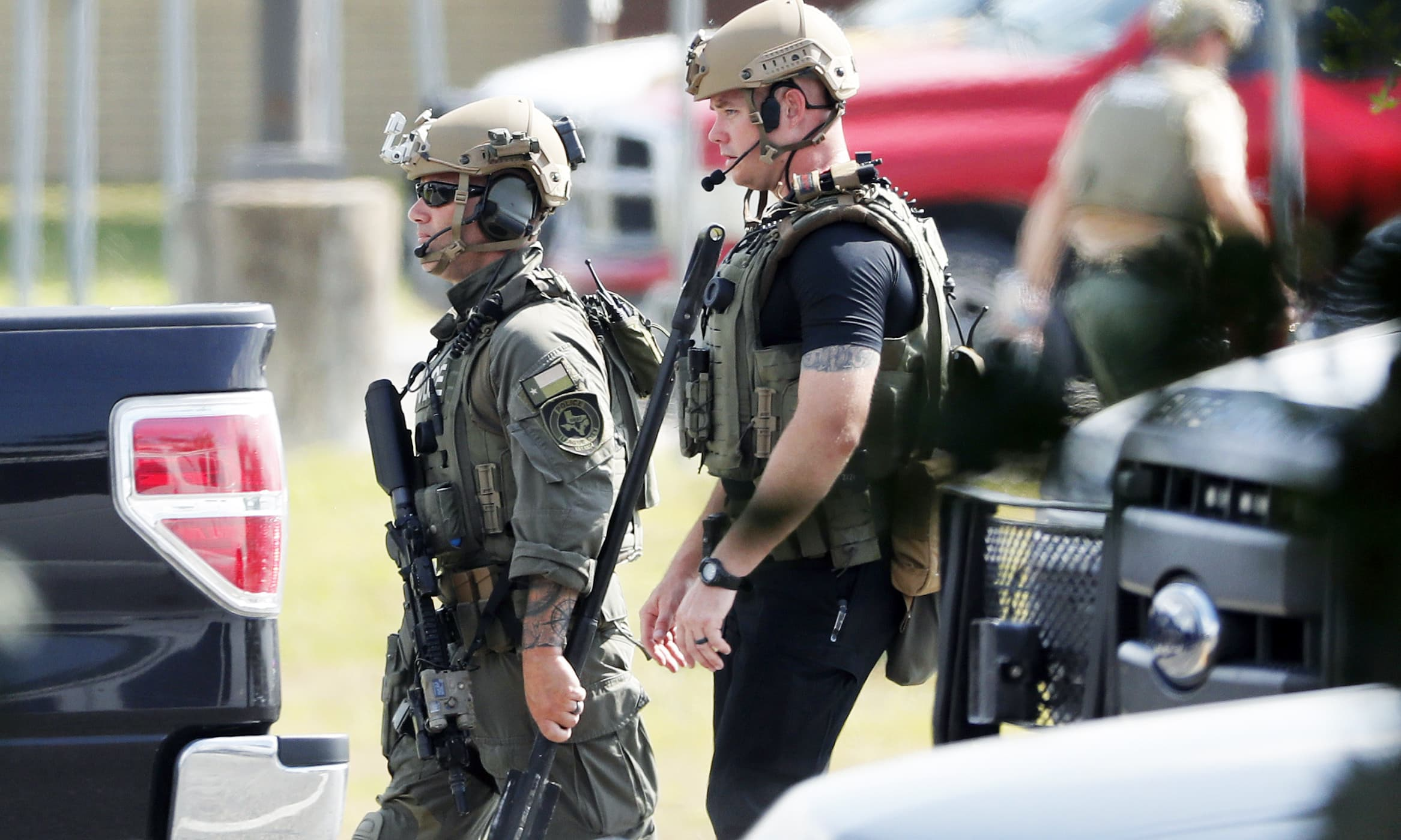 Police officers move through the scene at Santa Fe High School. —AP