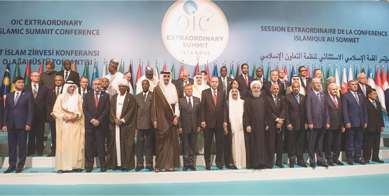 ISTANBUL: Leaders and representatives of the Organisation of Islamic Cooperation member states pictured during an extraordinary meeting of the OIC on Friday. In his opening address, Turkish Foreign Minister Mevlut Cavusoglu asked the OIC to stop other nations from following the United States and moving their embassies in Israel to Jerusalem. — Reuters