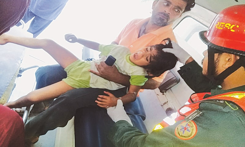 RESCUE 1122 personnel shift an injured child to the CMH.— Dawn