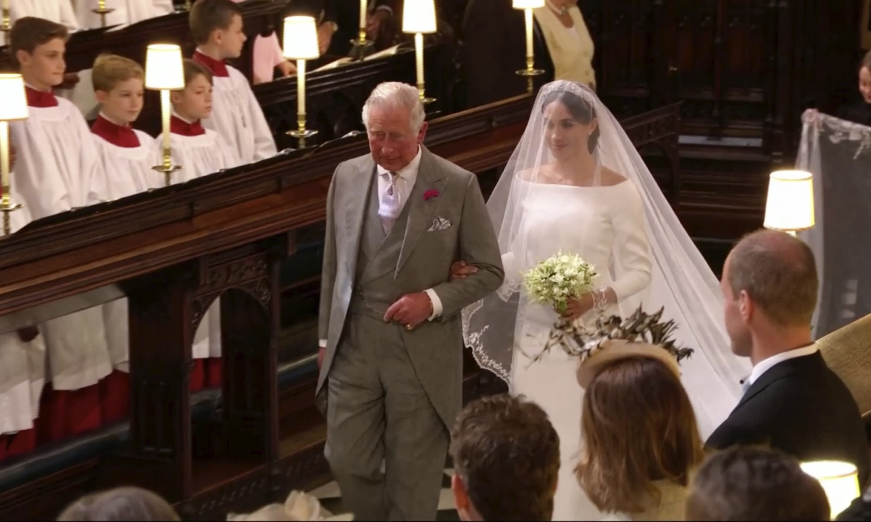 Meghan Markle walks down the aisle with Prince Charles for her wedding ceremony at St. George's Chapel in Windsor Castle. — AFP