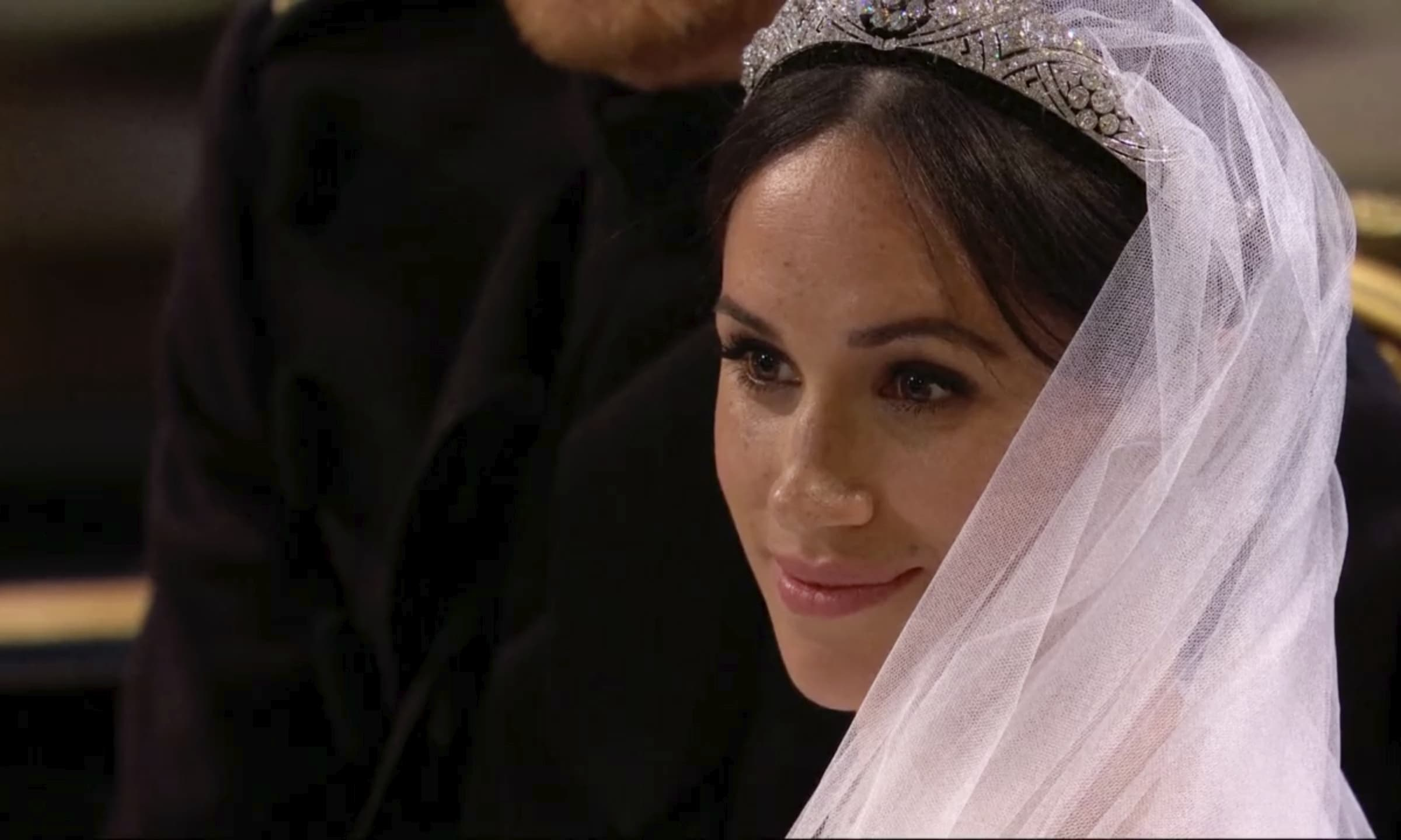 Meghan Markle listens during her wedding ceremony with Britain's Prince Harry at St. George's Chapel in Windsor Castle in Windsor, near London, England, Saturday, May 19, 2018.  (UK Pool/Sky News via AP)