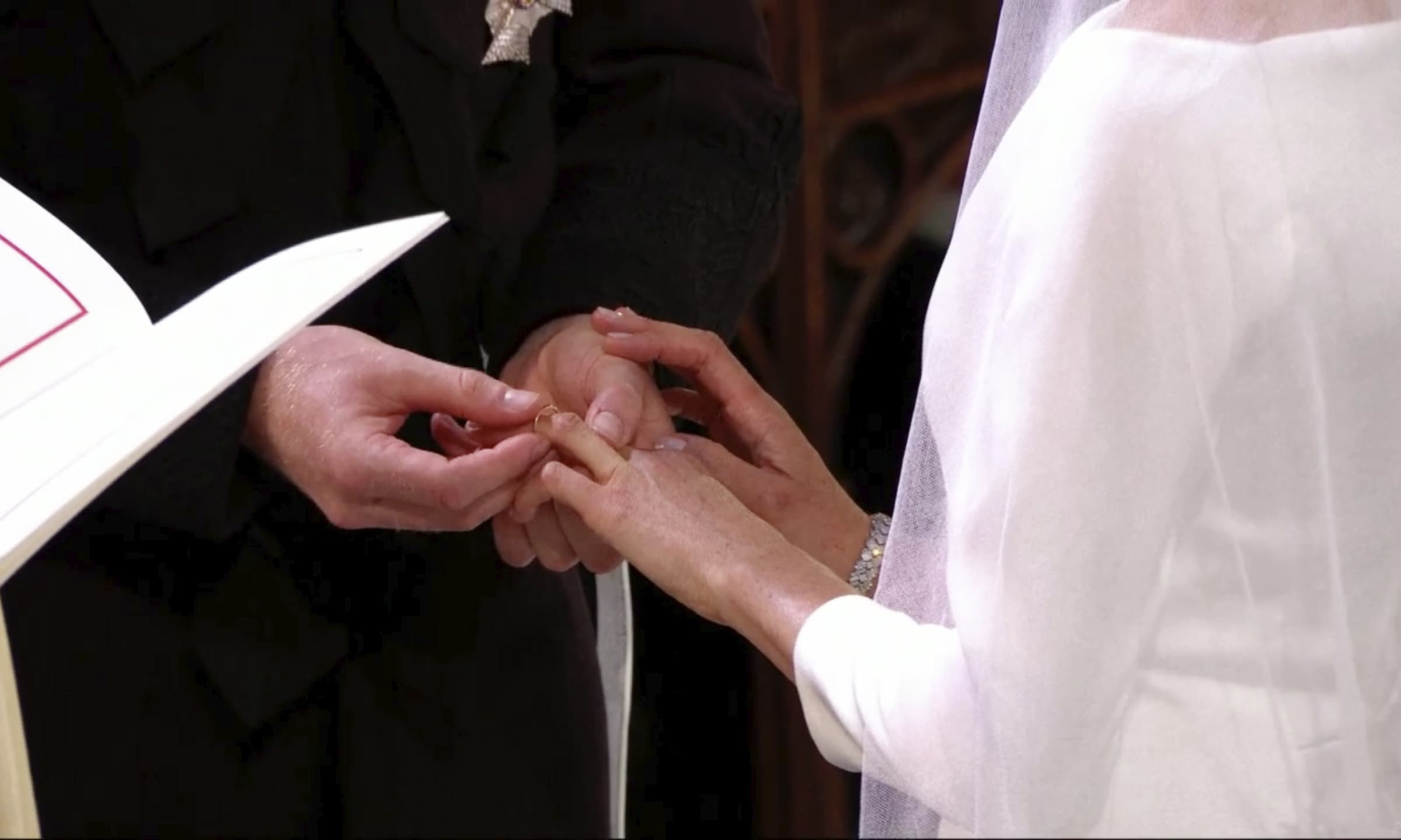 Prince Harry places a ring on Meghan Markle's finger during their wedding ceremony. — AP