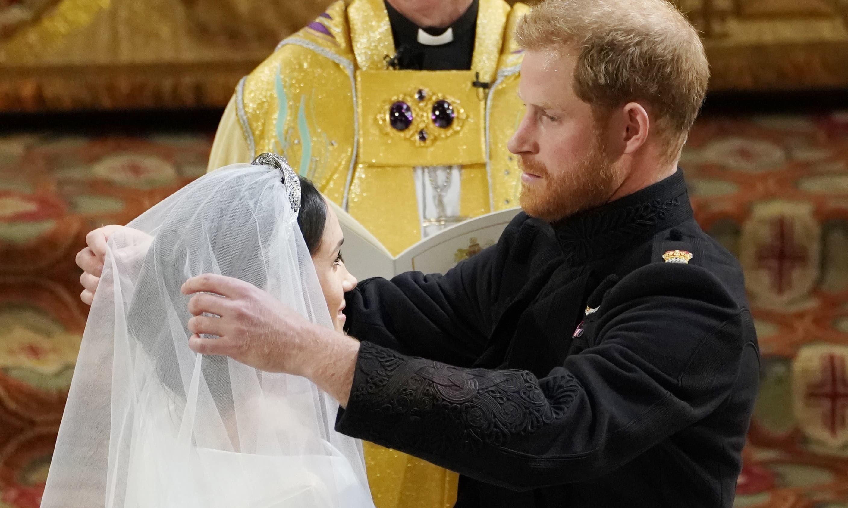 Prince Harry pulls back Meghan Markle's veil — AP