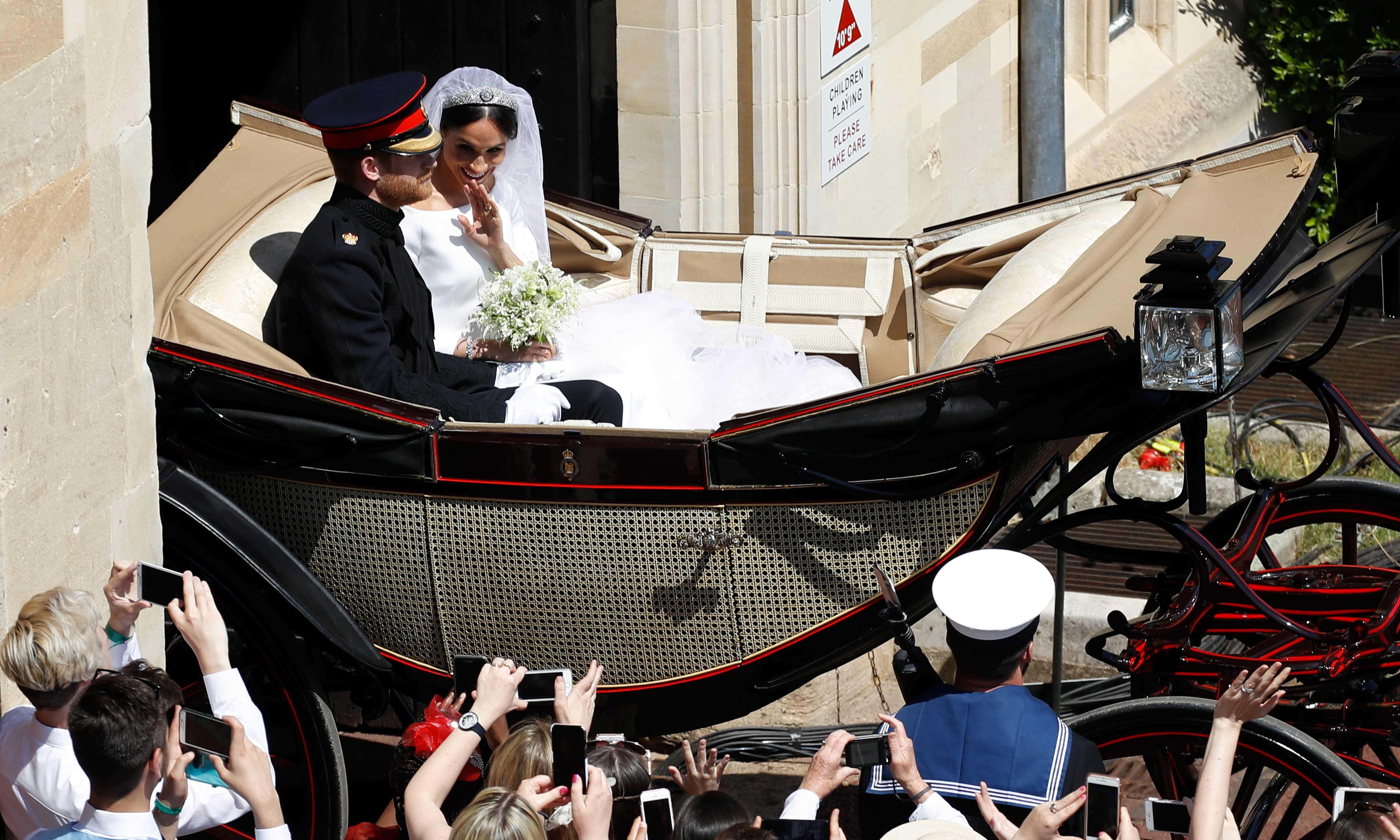 The newly-wed couple leave the St George Chapel — AP