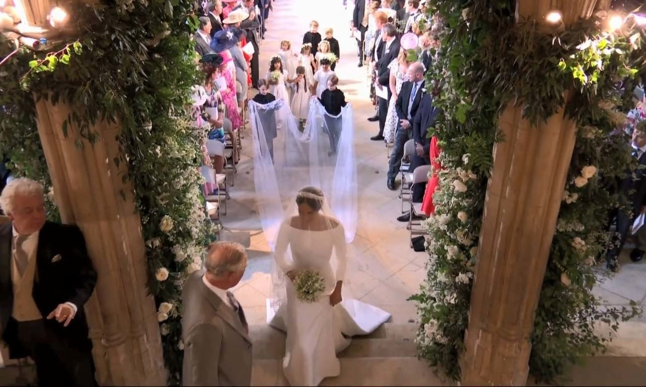 The bride walked up the aisle on her own before being joined half way by Harry's father Prince Charles. — AP