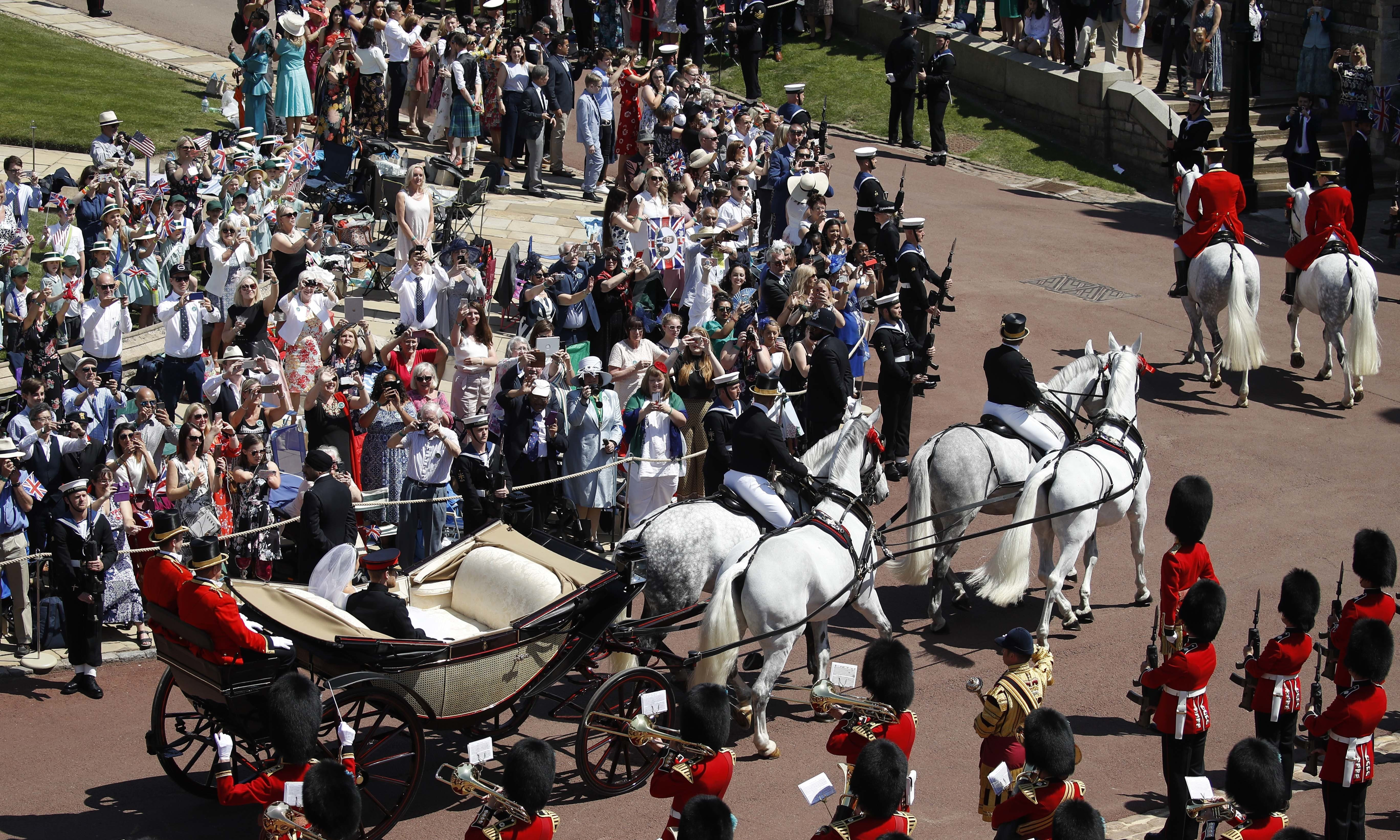 Prince Harry and Meghan Markle leave the chapel in a horse-drawn carriage. — AP