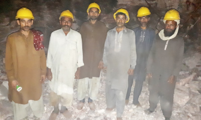 A group of miners pose in one of the salt mines of Khewra. — Photos by the writer