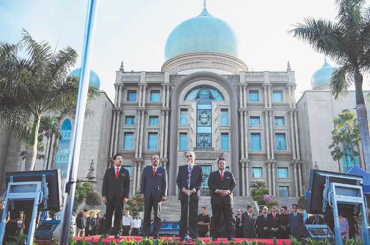 PUTRAJAYA: Malaysia's newly-elected Prime Minister Mahathir Mohamad (second right) addresses civil servants on Monday.—AFP