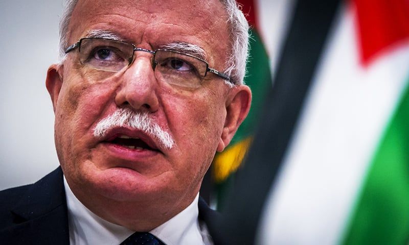 Palestinian Minister of Foreign Affairs Riyad al-Maliki speaks to the press following his talks with the ICC prosecutor at the International Criminal Court in The Hague.—AFP
