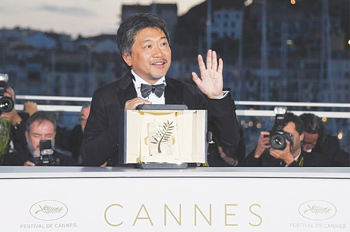 DIRECTOR Hirokazu Koreeda poses with the Palme d'Or award for his film Shoplifters at the Cannes Film Festival on Saturday. Koreeda is the fifth Japanese recipient of the top award at Cannes.