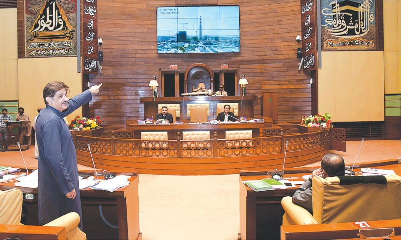 CM Shah presents a slideshow during Tuesday's assembly session.—APP