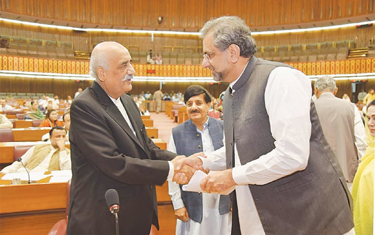 PRIME Minister Shahid Khaqan Abbasi shakes hands with Leader of the Opposition Syed Khursheed Shah in the National Assembly on Thursday.—PPI