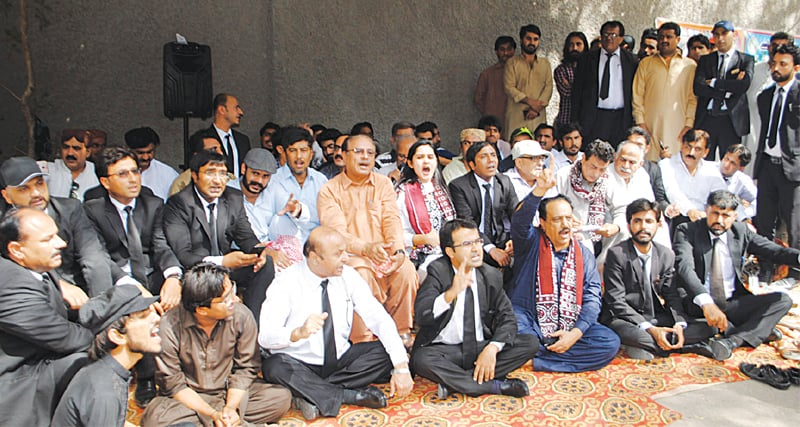 ACTIVISTS of various organisations hold a hunger strike outside the Hyderabad Press Club on Thursday.—Dawn