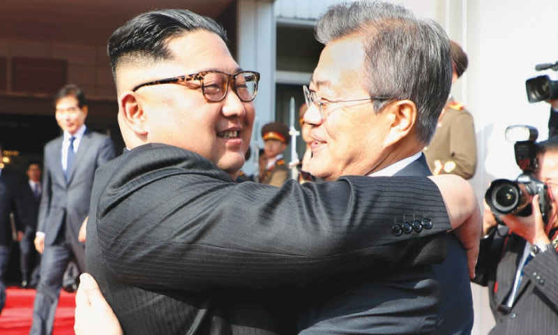SOUTH Korean President Moon Jae-in (right) embracing North Korean leader Kim Jong-un at the truce village of Panmunjom, North Korea, on Saturday.— Reutres