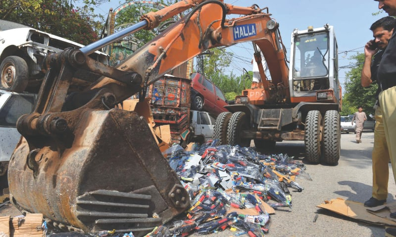 Toy guns confiscated by the police under a ban on their sale are being destroyed in Peshawar | Abdul Majeed Goraya / White Star
