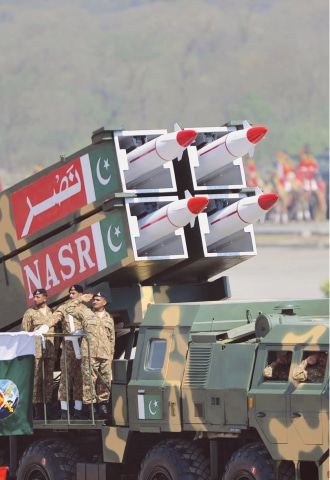 Military personnel stand beside short-range surface-to-surface missile Nasr during the Pakistan Day parade in Islamabad in 2015 | AFP