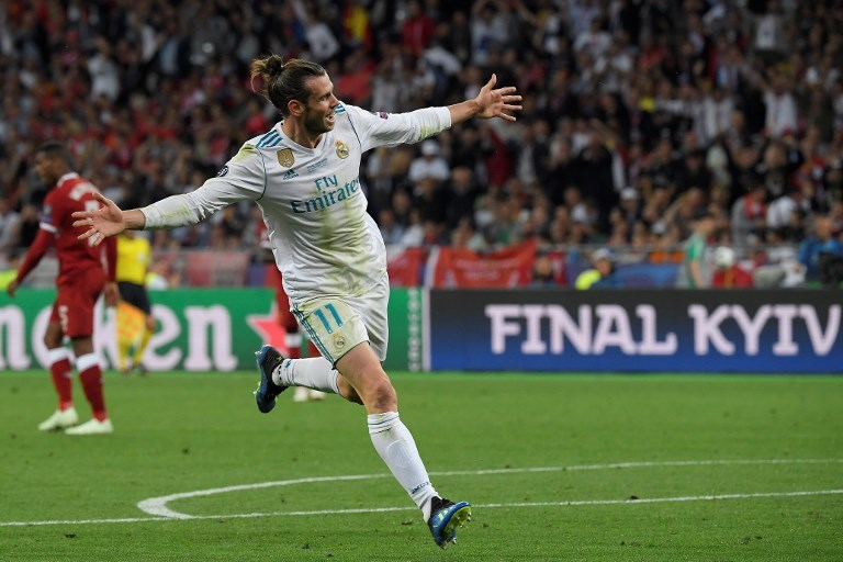 Real Madrid's Welsh forward Gareth Bale celebrates after scoring his second goal during the UEFA Champions League final football match between Liverpool and Real Madrid at the Olympic Stadium in Kiev, Ukraine on May 26. — AFP