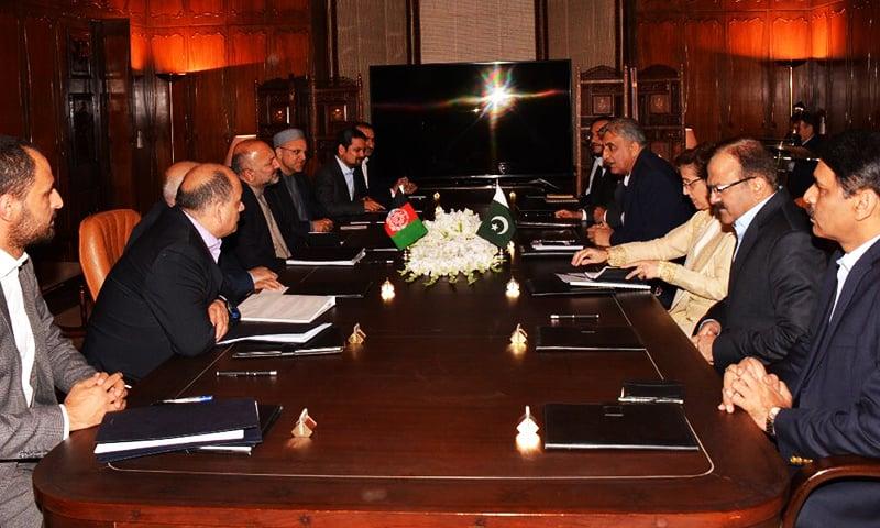 Afghan NSA-led delegation meeting with COAS Bajwa.— Courtesy: ISPR