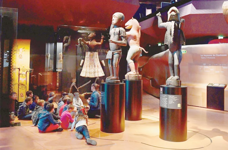AFRICAN statues, plundered by French troops in 1892 from the kingdom of Dahomey — modern-day Benin — are displayed in Paris' Quai Branly Museum.—AFP