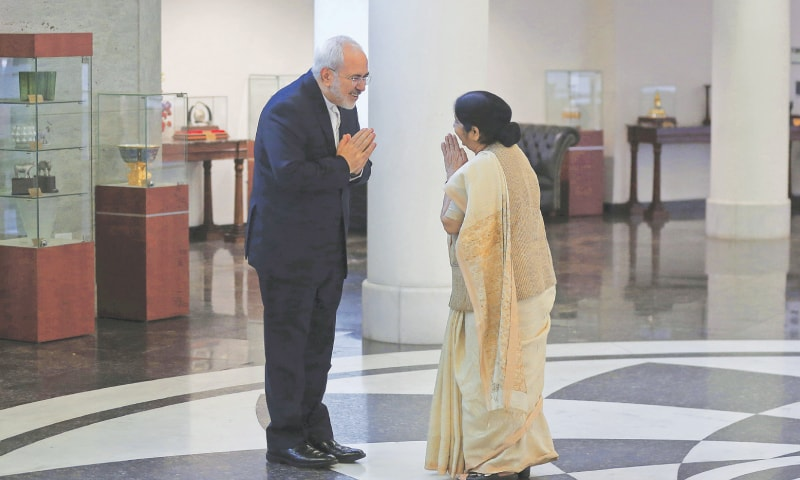 New Delhi: Indian Foreign Minister Sushma Swaraj (right) greets her Iranian counterpart Javad Zarif before their meeting.—AP