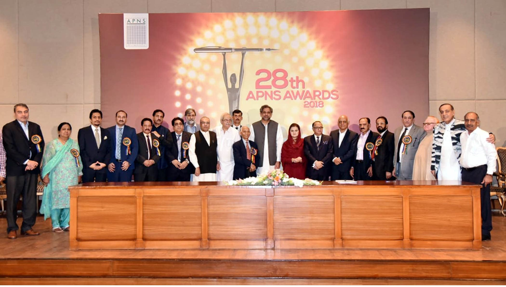 Prime Minister Shahid Khaqan Abbasi with awardees of the 28th All Pakistan Newspapers Society (APNS) Awards at PM Office in Islamabad on Wednesday. — PID