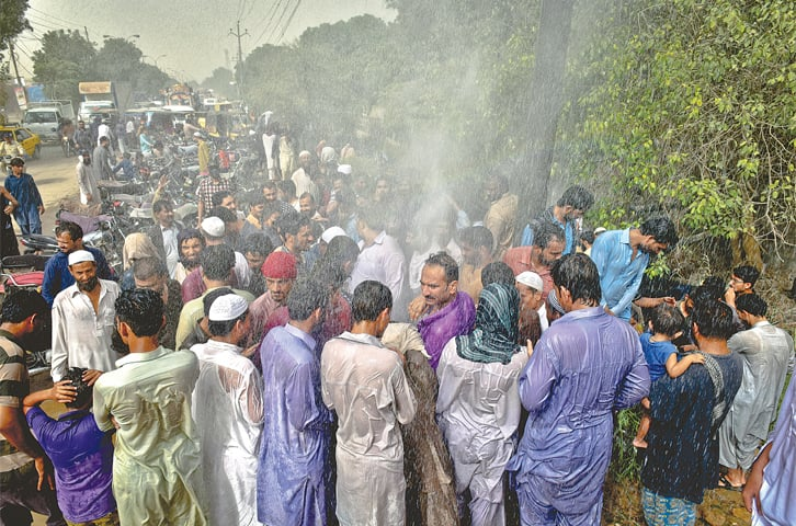 A WATER main in SITE has been punctured at various places where hoards of people have gathered. The water gushing out is helping people beat the sweltering Wednesday heat, but apart from the wastage, it also poses a threat to those passing by as right next to it is a drain carrying industrial waste.—Fahim Siddiqi / White Star