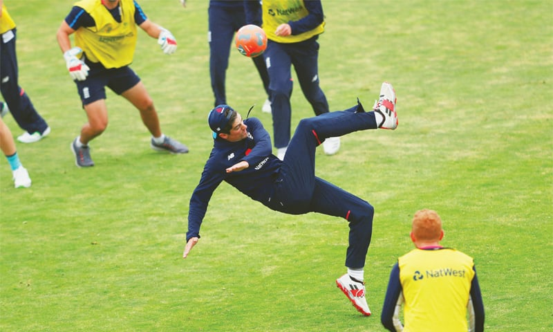 LEEDS: England batsman Alastair Cook attempts a bicycle kick during a training session at Headingley  on Tuesday.—Reuters