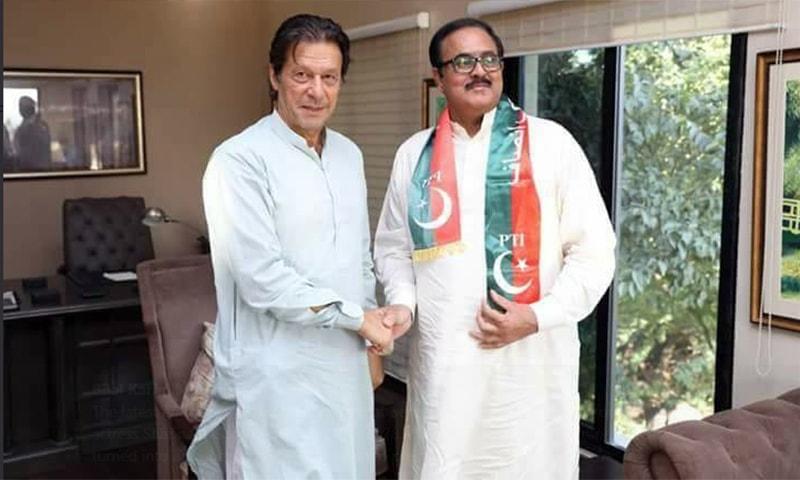A photo of PTI Chairman Imran Khan with Farooq Bandial. — Photo: Twitter