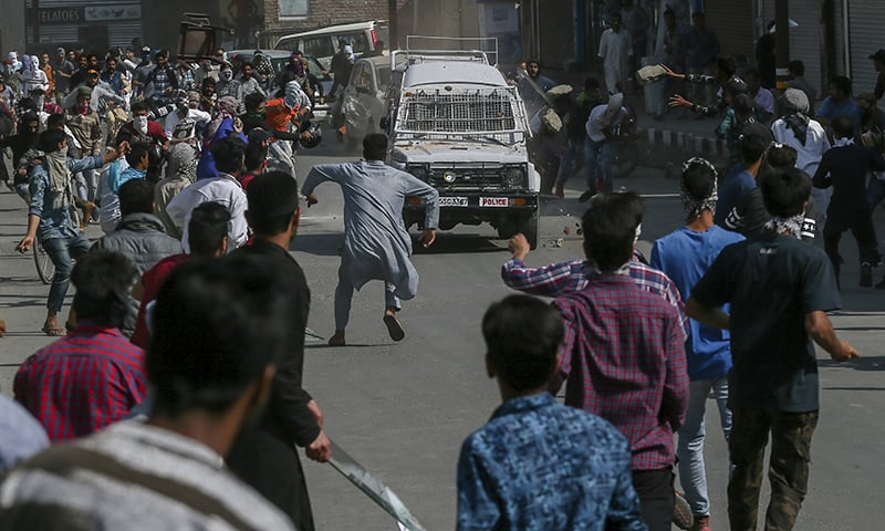Protesters throw rocks and bricks on a paramilitary vehicle in Srinagar. —AP