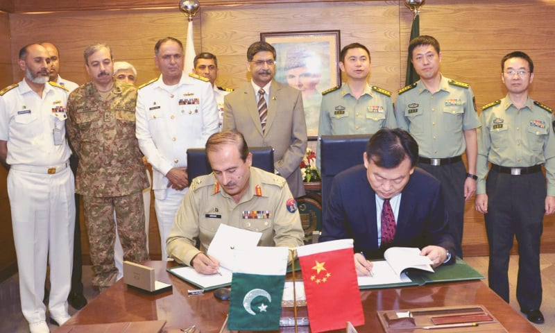 the contract for acquisition of two warships for Pakistan Navy being signed with China Shipbuilding Trading Company at the ministry of defence production on Friday. Deputy Chief of Naval Staff (Operations) Rear Admiral Faisal Rasul Lodhi was also present.—INP