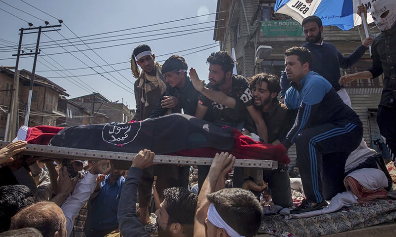 Kashmiri men carry body of Qaiser Amin Bhat, during his funeral in Srinagar. — AP