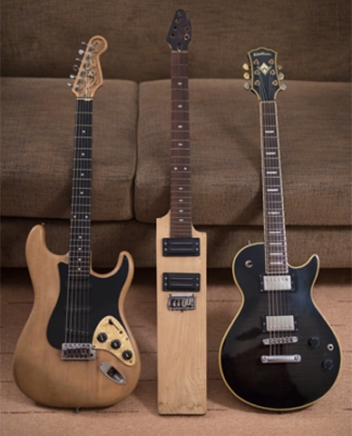 (Left) The modified Stratocaster that took over a month to restore. Aamir Zaki's brother Shahid had carved Zaki's initials on the headstock. (Middle) The unfinished bat guitar. (Right) The black Washburn that Zaki used the most in his last performances