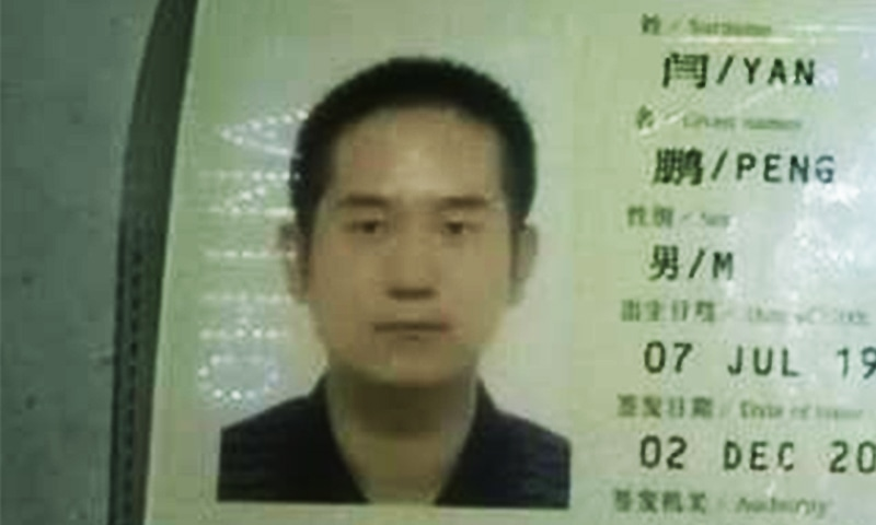 A close-up of an identification photo of the deceased Chinese engineer. ─ Photo by author