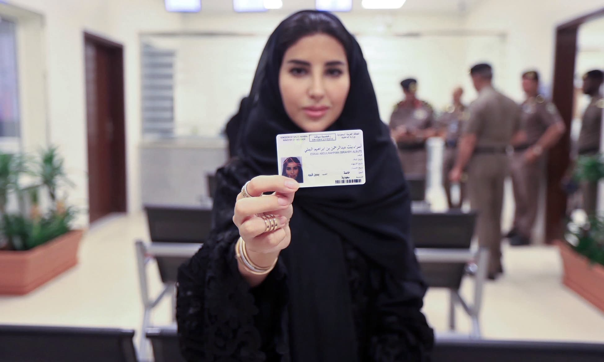 First Saudi women receive driving licences amid crackdown