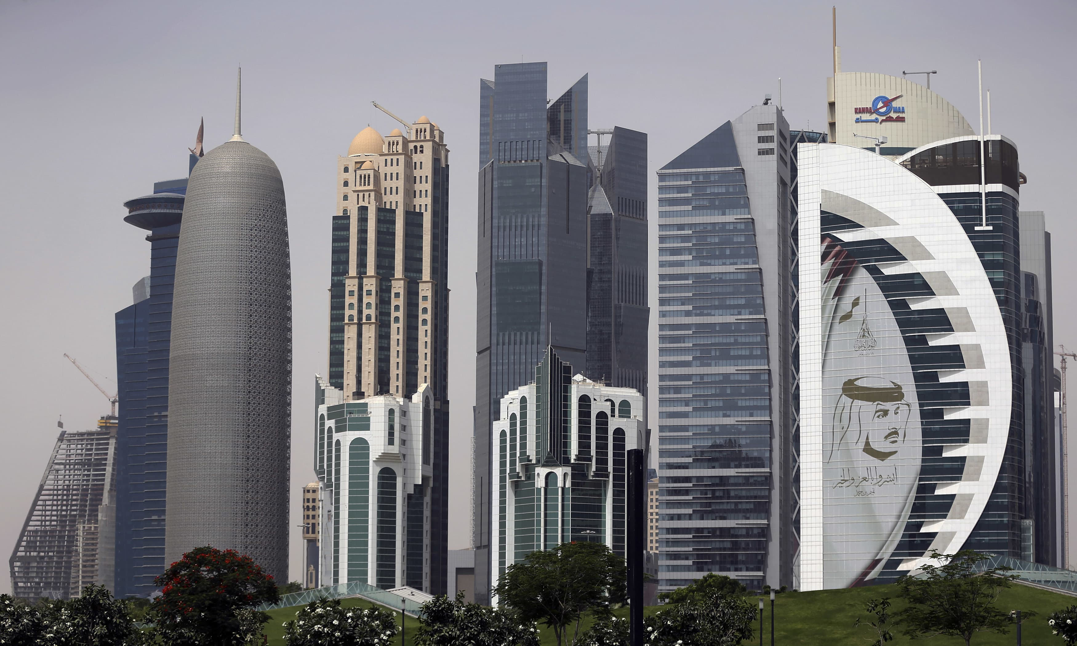 In this May 5, 2018 photo, a giant image of the Emir of Qatar Sheikh Tamim bin Hamad Al Thani, adorns a tower in Doha, Qatar. At a time when the U.S. hopes to exert maximum pressure on Iran, a regional bloc created by Gulf Arab countries to counter Tehran looks increasingly more divided ahead of the anniversary of the diplomatic crisis in Qatar. (AP Photo/Kamran Jebreili) — Copyright 2018 The Associated Press. All rights reserved.