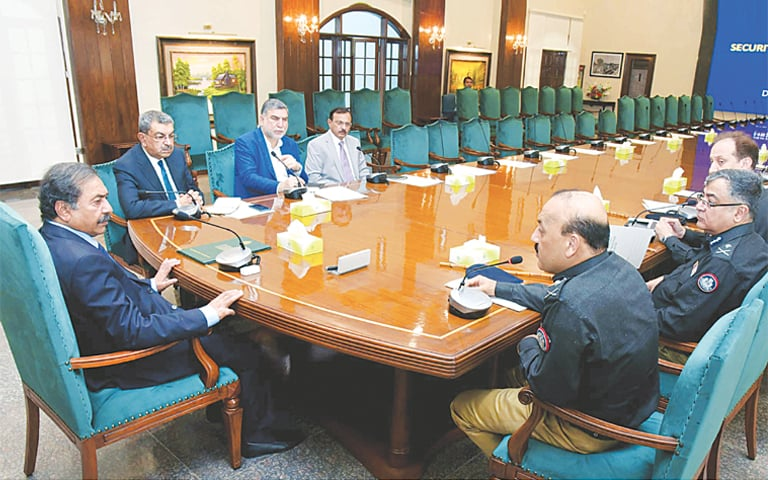 Caretaker Sindh Chief Minister Fazal-ur-Rahman presides over a meeting held to review the law and order situation on Monday.—PPI