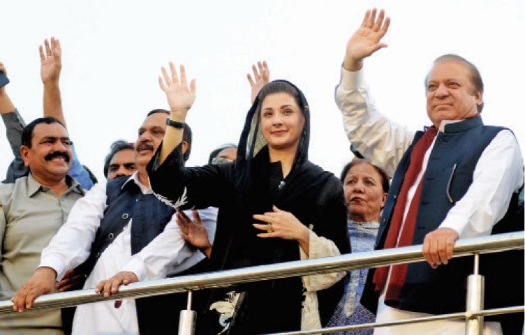 PML-N Quaid Nawaz Sharif, Maryam Nawaz and Malik Abrar wave to the crowd during the workers convention in Islamabad on Monday. — Photo by Mohammad Asim