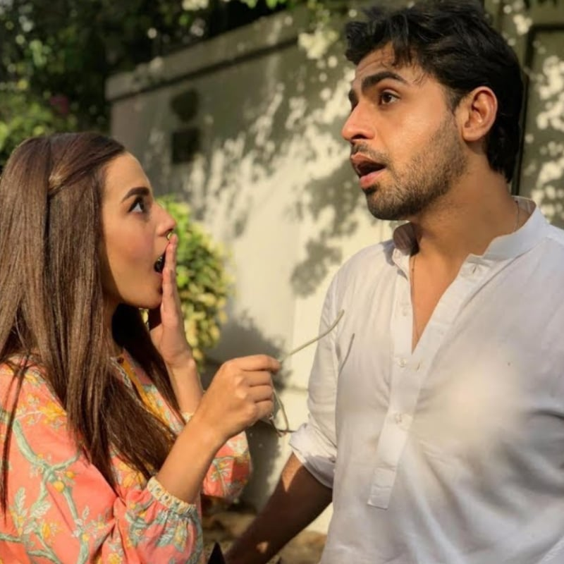 Iqra Aziz as Ajiya and Farhan Saeed as Arsalan